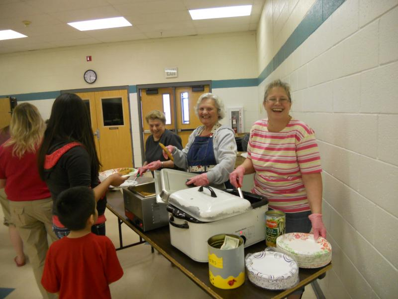 The crew from the Chamber and Head Start serving a delicious trout dinner.